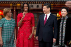 US first lady Michelle Obama, second from left, her mother Marian Robinson, left, share a light moment with Chinese President Xi Jinping and his wife Peng Liyuan. Photo / AP