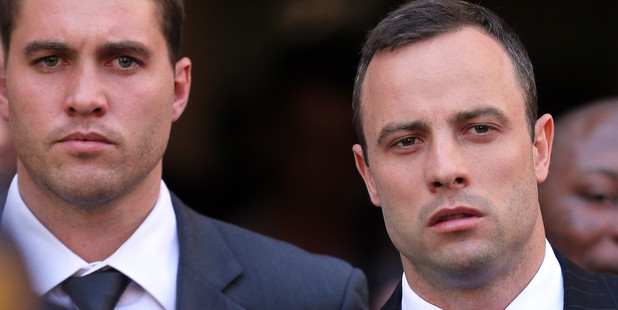Oscar Pistorius, right, leaves the the high court in Pretoria, South Africa. Photo / AP