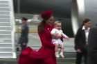 Britain's baby Prince George arrives in New Zealand with parents Prince William and Catherine for the eight-month-old's first ever official tour.