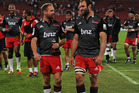 George Whitelock and Andy Ellis of Crusaders leaving the field after defeating Lions during the Super Rugby match between Lions and Crusaders. Photo / Getty Images.