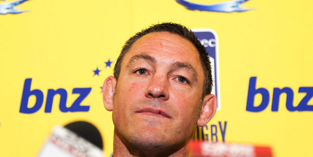 Coach Mark Hammett of the Hurricanes speaks to the media to announce he will not seek reappointment at the end of the 2014 season. Photo / Getty Images.