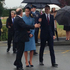 Prince William holding the umbrella over his wife as they exit the heritage centre, and make their way to the airfield . Photo / Teuila Fuatai