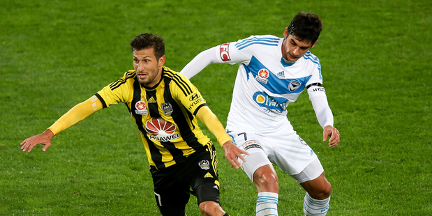 Vince Lia of the Phoenix beats the defence of Guilherme Finkler of the Victory during the round 27 A-League match between Wellington Phoenix and Melbourne Victory. Photo / Getty Images.