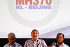 Malaysian acting Transport Minister Hishammuddin Hussein, centre. Photo / AP