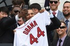 Red Sox Designated Hitter David Ortiz (L) taking the controversial selfie with US President Barack Obama. Photo / AP
