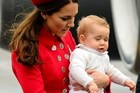 Catherine, the Duchess of Cambridge, carries baby Prince George upon their arrival at the international airport in Wellington. Photo / AFP