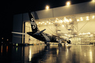 The Air New Zealand 787-900 painted in black is moved out of the Boeing painting hangar in Seattle. Photo / Brett Phibbs