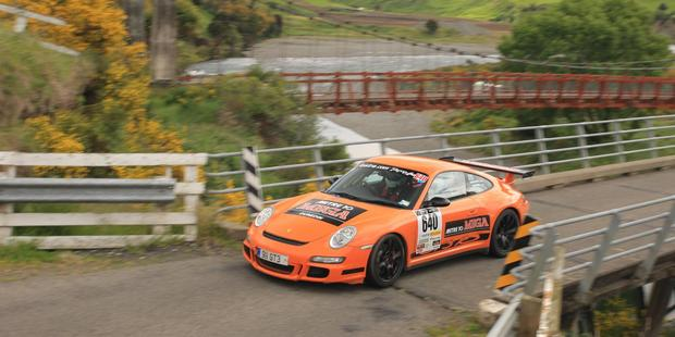 Last year's Targa New Zealand winners Martin Dippie and Jona Grant in their 2007 Porsche 997 GT3, above; and, below, entries for the non-competitive Targa Tour are rising each year.  Pictures / Groundsky