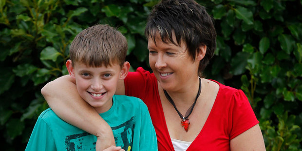 Anita Stokes with her son Cameron. Anita went through menopause at 29 and had twin boys through an egg donor. Photo / Christine Cornege
