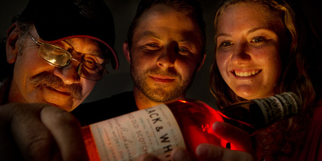 Bill Pomare (left), Cameron Lammas and Nicki Main with the bottle of whisky. Photo/Stephen Parker
