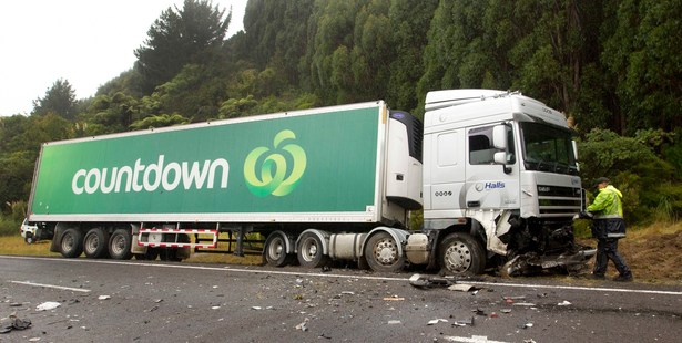 Police pictured at the scene of a serious crash between a car and a truck that happened earlier today on State Highway 30 in the Eastern Bay of Plenty. Photo / Alan Gibson