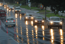 Car lights reflect on a wet Waihi Rd this morning, as a severe weather watch is issued for the Bay of Plenty. Photo/John Borren