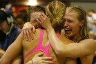 Ellen Quirk and Samantha Lucie-Smith of the women's 4x100m relay team celebrate with team mate Laura Quilter after qualifying for the Commonwealth Games. Photo / Simon Watts