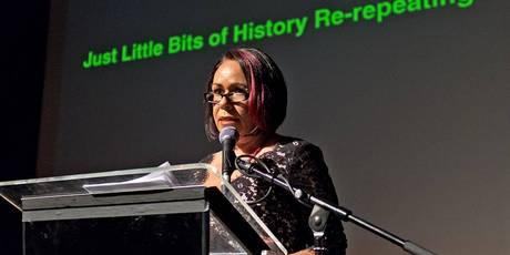Australian artist-curator Fiona Foley giving the keynote address in London.