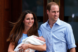 Prince William and Kate, Duchess of Cambridge hold the Prince George.