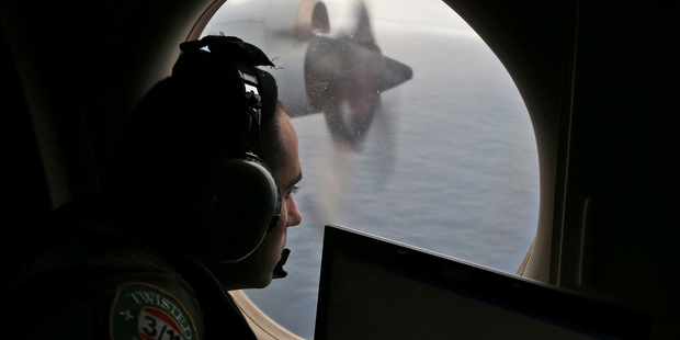 Flight officer Rayan Gharazeddine on board a Royal Australian Air Force AP-3C Orion, searches for the missing Malaysia Airlines Flight MH370. File photo / AP