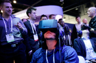 Man plays a video game wearing an Oculus Rift virtual reality headset. Backers helped Oculus raise more than $2.4m through Kickstarter before it sold to Facebook for $2.3b. Photo / AP
