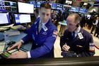 Specialist and trader on the floor of the New York Stock Exchange. Photo / AP