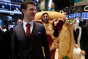 GrubHub CEO Matthew Maloney walks the New York Stock Exchange trading floor. Grubhub surged in its first day of trading. Photo / AP