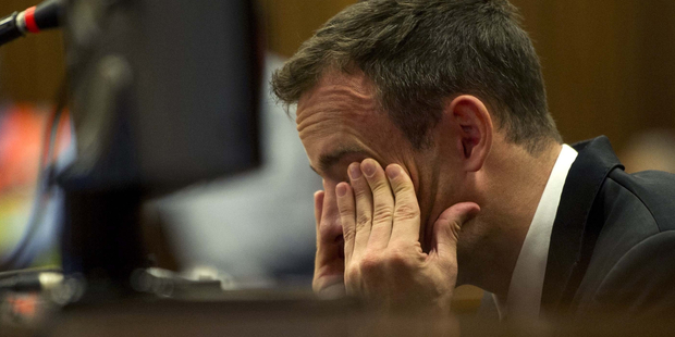 Oscar Pistorius reacts as he listens to evidence by a pathologist in court in Pretoria. Photo / AP