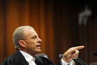 State prosecutor Gerrie Nel during cross questioning of Oscar Pistorius. Photo / AP