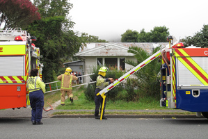 Firefighters at the scene of a suspicious fire in Moerewa this morning.