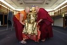 Whangarei-based Tibetan lamas Venerable Karma Gyafey, left, and Venerable Geshe Jamyang Sherab carry a statue of Buddha into the Old Library in preparation for the exhibition. Photo / John Stone