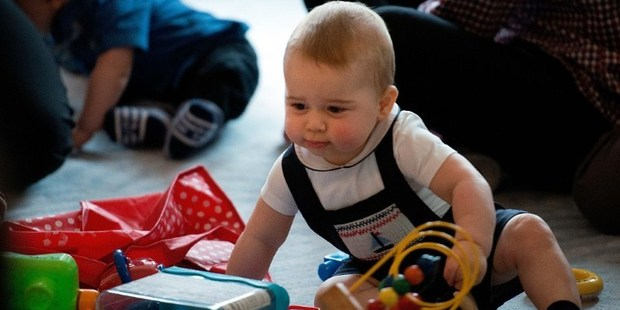 Prince George was dressed in navy smocked dungarees with a sailboat design. Photo / AFP