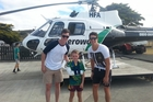 Wanganui's most improved under-13 cricketer Carter Hobbs, sporting a freshly broken arm, is flanked by Black Cap Adam Milne (left) and CD bowler Ben Wheeler ahead of a scenic helicopter flight in an Aero Work chopper last weekend. Photo/Supplied