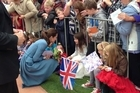 A little girl does a twirl for the Duchess in Blenheim. 