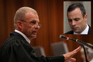 Prosecutor Gerrie Nel, left, earned his reputation as the 'pit-bull' for his gruelling questioning of Oscar Pistorius, during the athlete's third day in the witness box. Photo / AP