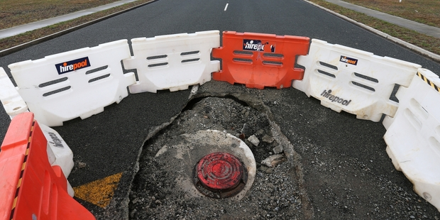 Manholes have collapsed and the road closed at the new Marsden City development. Photo/File