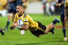 TJ Perenara scores for the Hurricanes in their Super Rugby win over the Blues. Photo / Getty Images