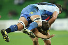 Wilhelm Steenkamp of the Force tackles Luke Jones of the Rebels during their Super Rugby encounter. Photo / Getty Images
