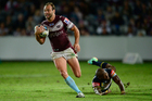 Brett Stewart makes a break during his side's win over the Cowboys. Photo / Getty Images