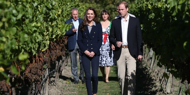 Prince William and Catherine stroll among the vines during their well-publicised visit to Amisfield Winery. Photo / AFP