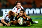 Chiefs halfback Augustine Pulu is tackled by Rebels No9 Nic Stirzaker. Photo / Getty Images