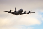 An RNZAF Orion takes off on what could be the final day of the aircraft search for the Boeing 777. Photo / AP