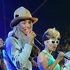 Pharrell Williams, second from left, performs with backup dancers during his set. Photo / AP