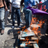 A protester puts his leg in a fire while perform a voodoo ceremony before the start of anti-government protest in Port-au-Prince, Haiti. Photo / AP
