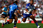 Tony Williams of the Bulldogs looks for a way past Konrad Hurrell of the Warriors during the round 6 NRL match between the Warriors and the Bulldogs. Photo / Getty Images.