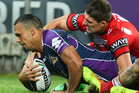 Will Chambers of the Storm is tackled by Gareth Widdop of the Dragons during the round 6 NRL match between the Melbourne Storm and the St George Illawarra Dragons. Photo / Getty Images.