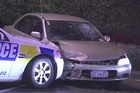 Two men were seriously injured when a stolen car crashed during a police pursuit in central Auckland following a string of aggravated robberies overnight.