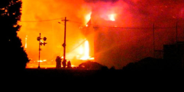 It took more than 90 firefighters from Invercargill, Gore, Mataura, Pukerau, Tapanui, Riversdale and Wyndham to control a fire at Livestock Supplies, in Gore. Photo / Russell Fredric via ODT