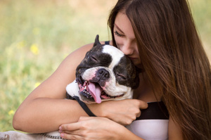Giving that pooch a cuddle will help unlock joy in your life. Photo / Thinkstock