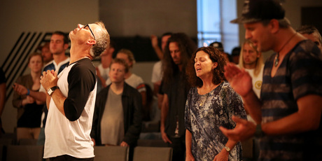 Senior minister Greg Burson leads worshippers at Edge Kingsland. Photo / Jason Oxenham.