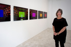 Trish Clark with works by Kimsooja and Hiroshi Sugimoto. Photo / Sarah Ivey