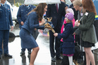 The Duchess of Cambridge is presented with a toy police dog. Photo / Mark Mitchell