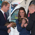The Duke and Duchess of Cambridge holding puppies during their visit to the Royal New Zealand Police College at Porirua on day ten of their tour of New Zealand. Photo / Mark Mitchell