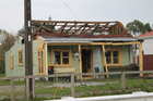 Strong winds associated with the remnants of Cyclone Ita hit the West Coast of the South Island today yesterday. A house at Cobden lost its roof. Photo / The Greymouth Star